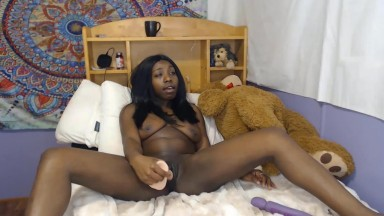 Curvy squirting ebony babe with a big butt and creamy twat