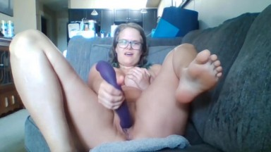 Leo Moon uses a purple dildo on her wet pussy to orgasm