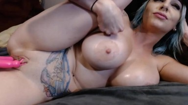 Completely nude Dahlia playing around with her oiled tits