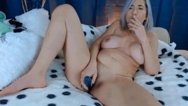 Horny Miss smokes while fucking her incredibly hairy cunt