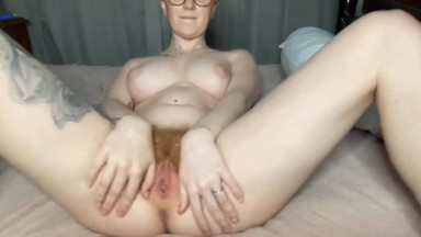 Busty British blonde Jessie Woods fingers her hairy twat