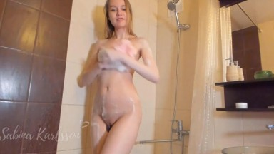 Sabina Karlsson lathers up in the shower before cumming