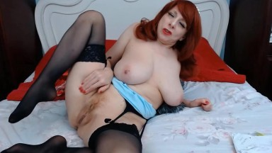 Mature redhead fox Ruby in sexy lingerie fingers her cunt