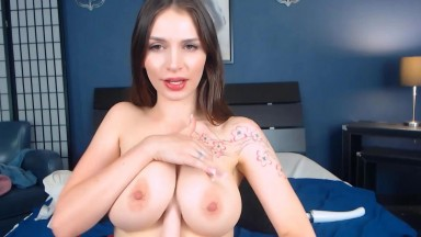 Tawny Michelle loves to feel a hard cock between her big tits