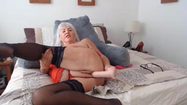 Horny GILF Melissa talks dirty and plays with her wet cunt